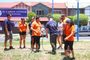 Cochabamba, Bolivia, 2015. Water and Canal Rescue. GMR volunteers pictured in blue shirts- Left: Sean Carris, Middle: Ariany Melgar, Right: Scott Walker.